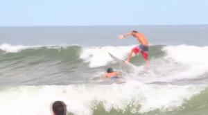 Thiago Camarão jumping over a dude.